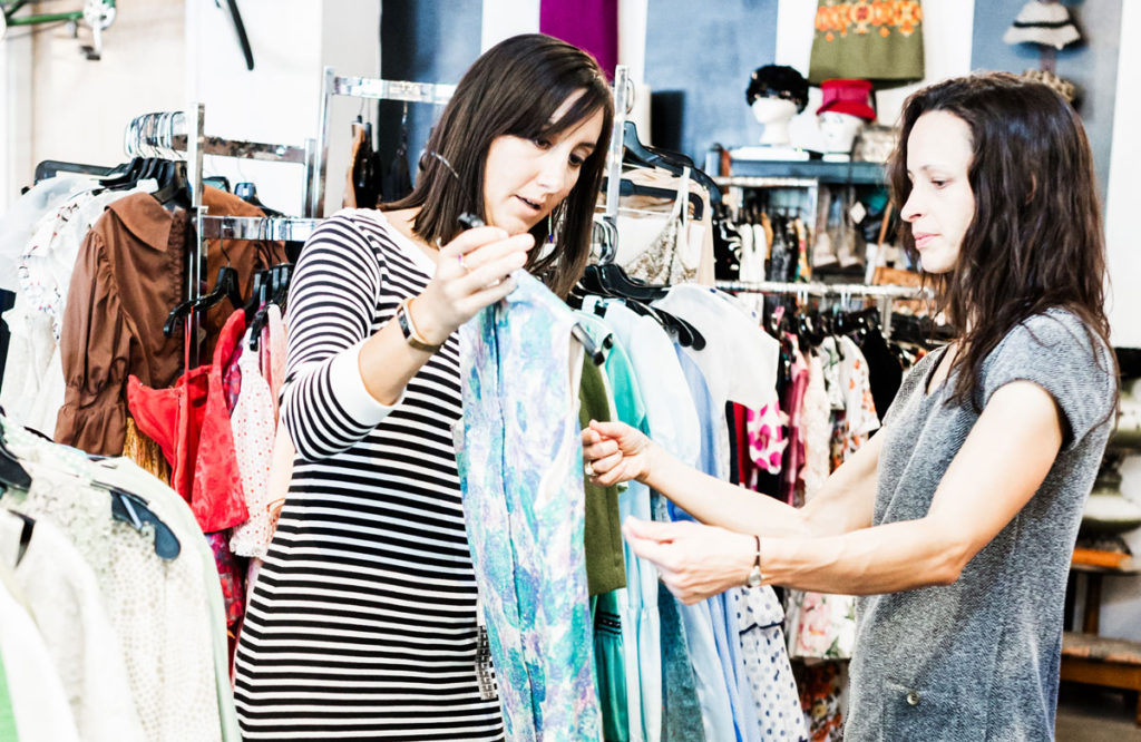 Loren North takes a client shopping at a local vintage store