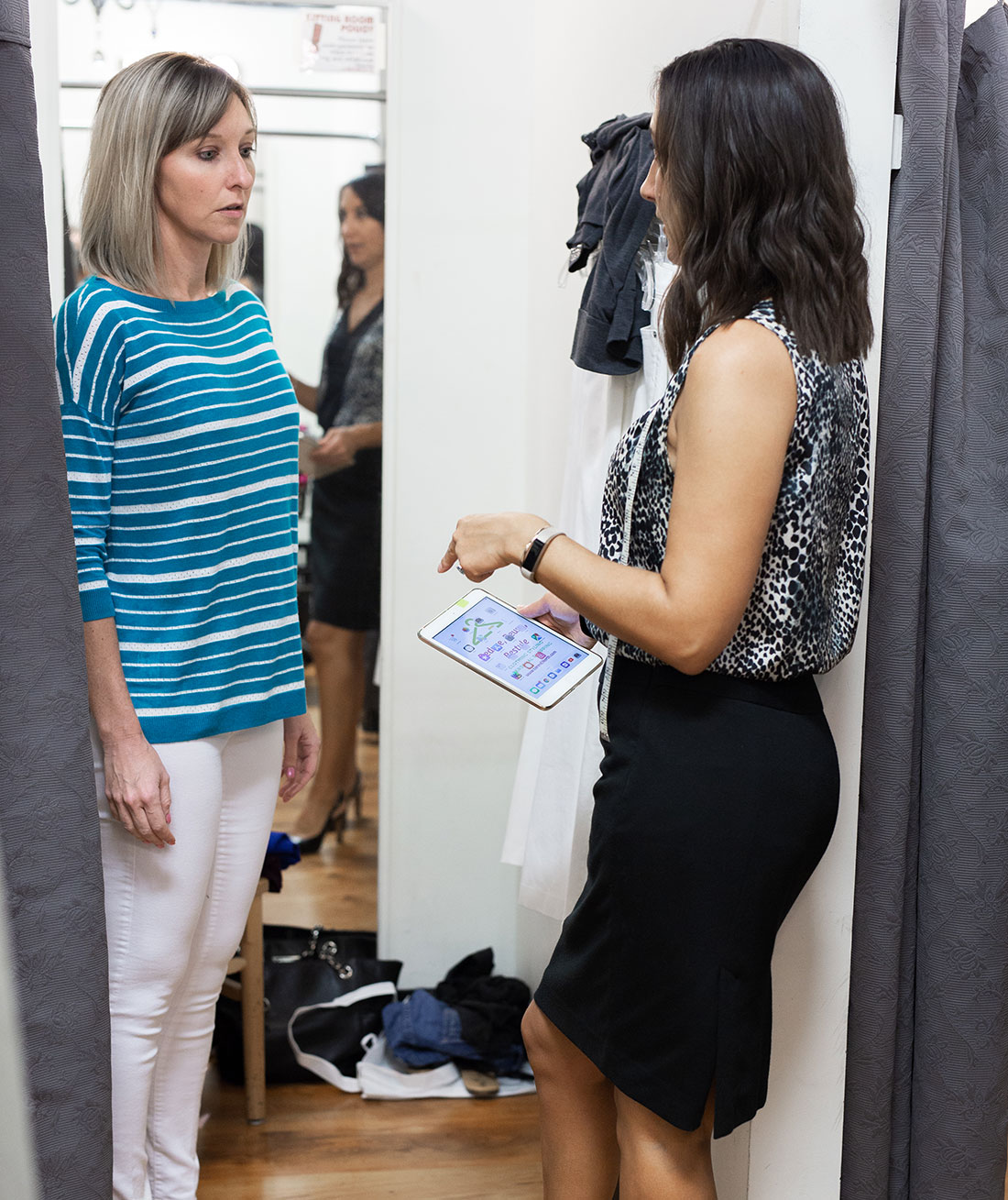 Loren North, clothing stylist, with client